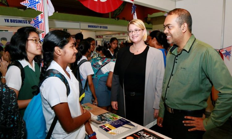 Students seeking information at the Education USA booth during the annual Education Fair